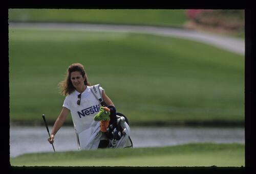 A female caddie on the bag at the 1991 Bay Hill Nestle Invitational Golf Championship