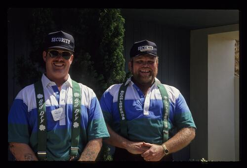 Two security staff smile fo rthe camera at the 1991 Bay Hill nestle Invitational Golf Championship
