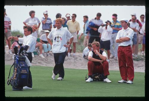 European teammates Colin Montgomerie and David Gilford watch their opponent's shot at the 1991 Ryder Cup