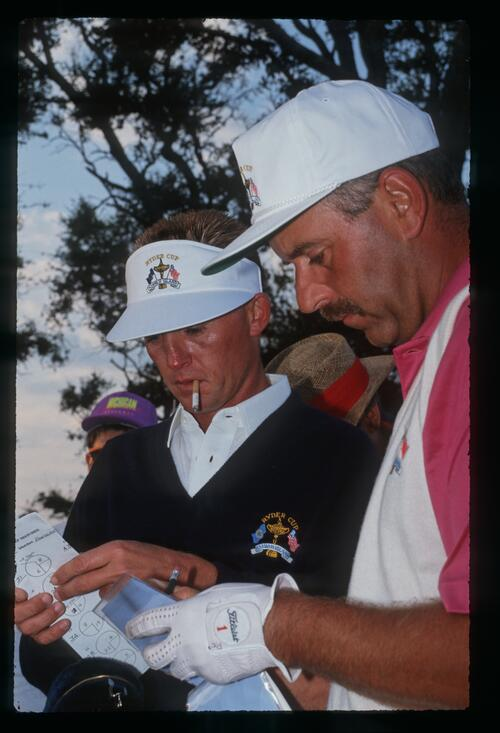 European player Mark James compares notes at the 1991 Ryder Cup
