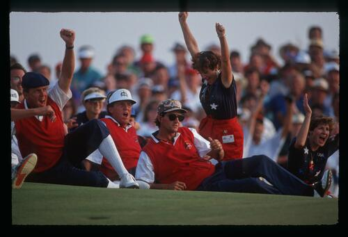 American golfers Payne Stewart, Mark Calcavecchia, and Steve Pate react to a team victory at the 1991 Ryder Cup