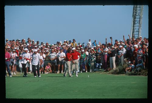 American golfer Fred Couples congratulates playing partner Payne Stewart on a well-deserved half in their match against Seve Ballesteros and Jose Maria Olzabal at the 1991 Ryder Cup