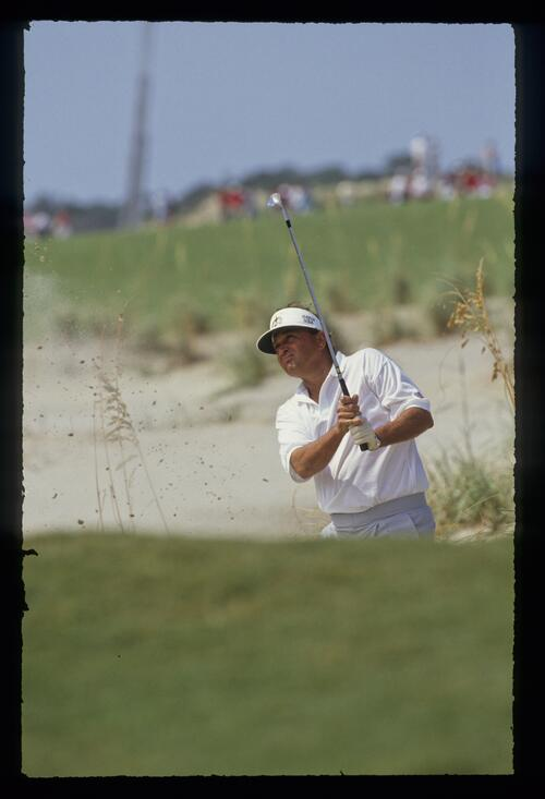 American Ray Floyd splashes from the greenside bunker at the 1991 Ryder Cup