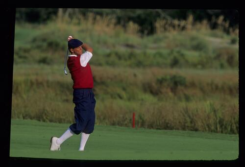 Dressed in red, white and blue, American golfer Payne Stewart shows form as plays his approach shot at the 1991 Ryder Cup