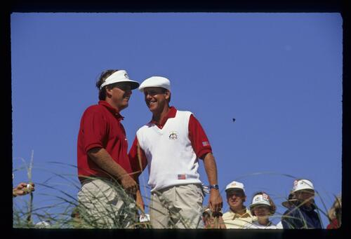 American golfers Mark Calcavecchia and Payne Stewart share a lighthearted moment at the 1991 Ryder Cup
