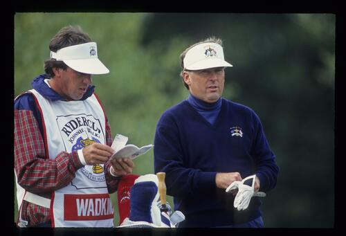 America's Lanny Wadkins checks the yardage with his caddie at the 1993 Ryder Cup