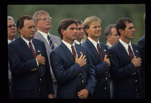 The 1993 American Ryder Cup team stand for the playing of the American Anthem during the Opening Ceremony at The Belfry