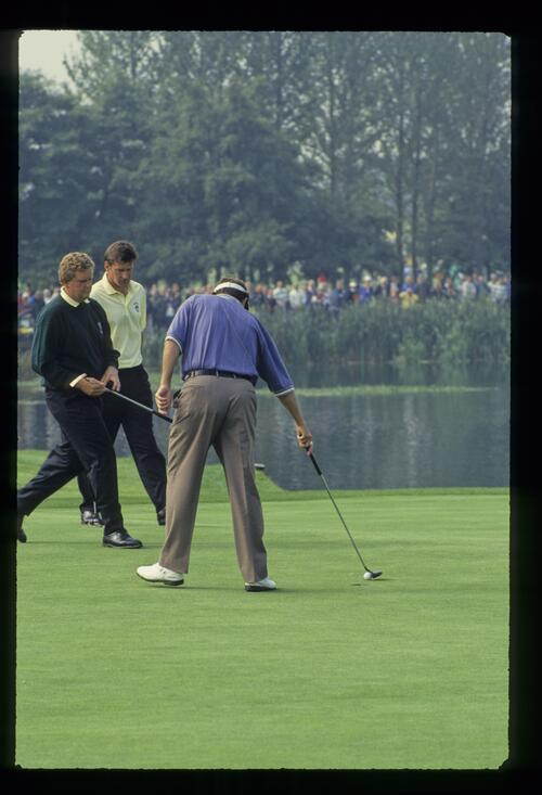 American Ray Floyd concedes the putt to European Colin Montgomerie in their match at The Belfry during the 1993 Ryder Cup