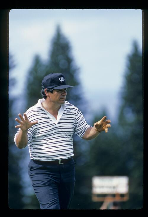 Lee Trevino gesturing with his hands during the 1984 Kapalua International