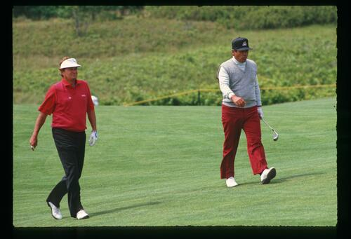 Ray Floyd and Lee Trevino on the fairway together during the 1986 US Open