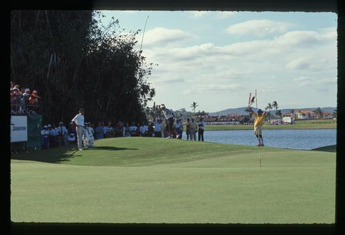Golfer Rodger Davis celebrates as his chip shot nears the hole for the win at the 1990 Daikyo Palm Meadows Cup Championship