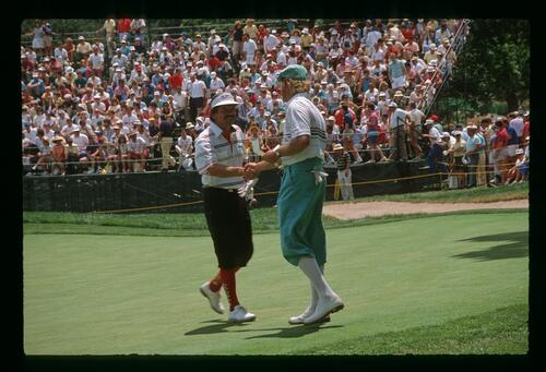 Both dressed in their trademark Plus-Fours, Rodger Davis shakes hands with opponent Payne Stewart at the 1988 United States Open Championship at Brookline