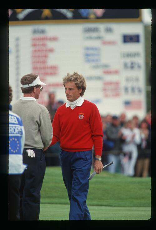 European golfer Bernhard Langer shakes hands with America's Tom Kite after suffering a crushing defeat of 5 and 3 on the final day of the 1993 Ryder Cup