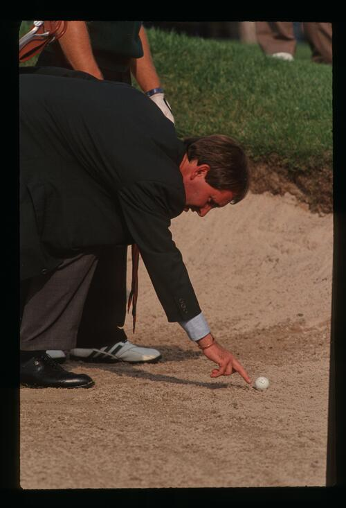 An official makes a ruling on a ball in the bunker at the 1993 Ryder Cup