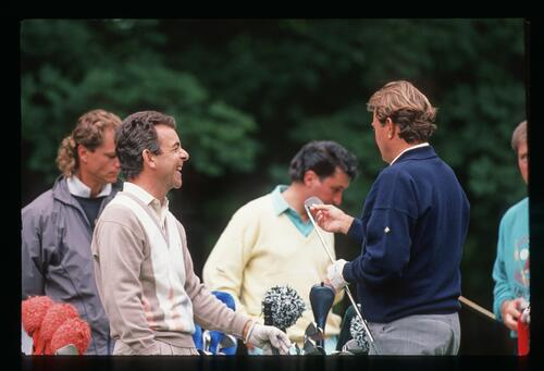 Golfers Tony Jacklin and Ray Floyd share a laugh at the 1988 Open Championship at Royal Lytham and St Annes