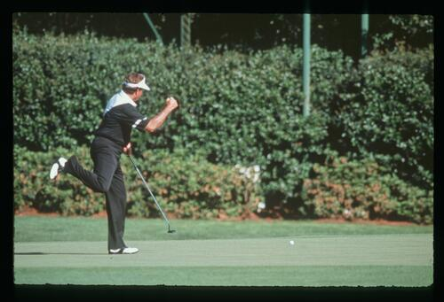 Golfer Ray Floyd holes his putt at the 1990 Masters Championship at Augusta