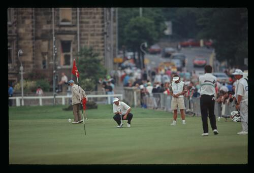 American golfer Ray Floyd surveys his putt on the 17th hole of the Old Course at St Andrews during the 1990 Open Championship