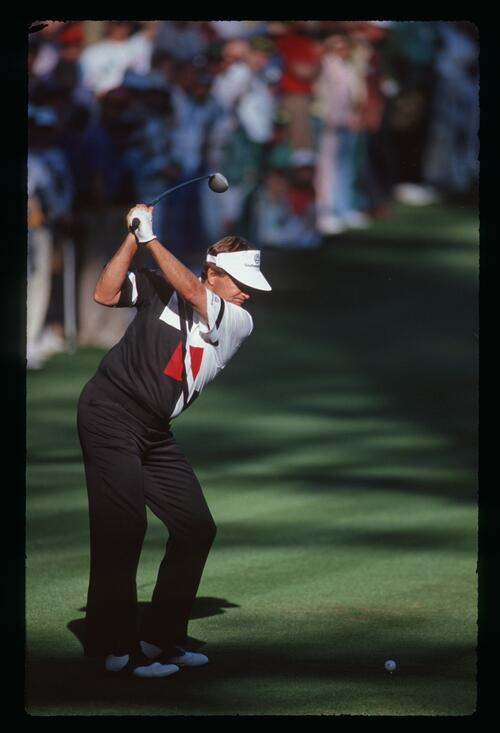 Golfer Ray Floyd tees off at the 1990 Masters Championship