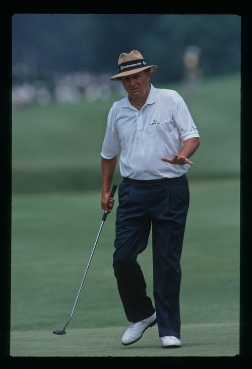 Golfer Ray Floyd motions for his ball to settle at the 1993 United States Open Championship