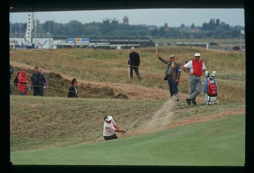 American golfer Ray Floyd blasts his ball out of the fairway bunker at the 1993 Open Championship