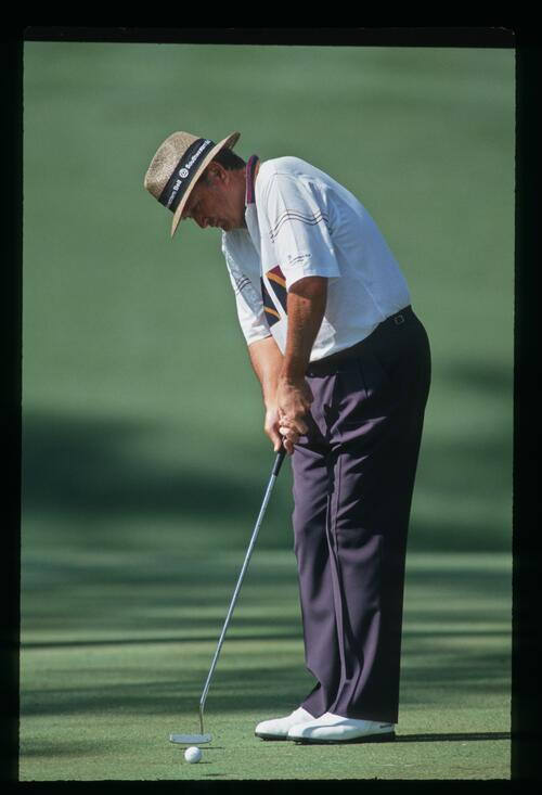 Raymond Floyd taps in his short putt on the 10th hole at the 1993 Masters Championship