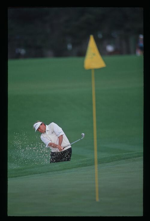 Ray Floyd plays out of the greenside bunker at the 1992 Masters Championship