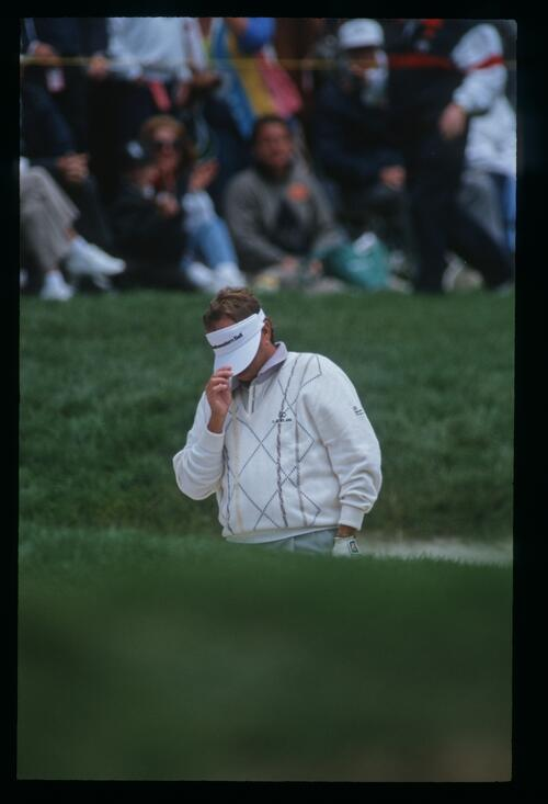 Golfer Ray Floyd covers his face after his poor shot in the bunker at the 1992 United States Open Championship