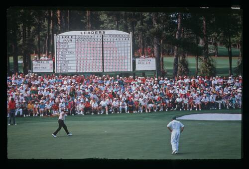 Raymond Floyd holes his birdie putt on the 15th hole to go one off the lead at the 1992 Masters Championship