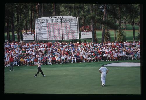 Golfer Ray Floyd reacts as his birdie putt nears the hole on the 15th at the 1992 Masters Championship