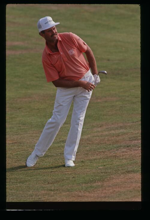 Golfer Mark James keeps a close eye on his approach shot at the 1989 Open Championship