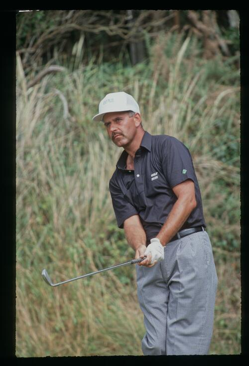 Golfer Mark James watches his shot closely at the 1991 Open Championship