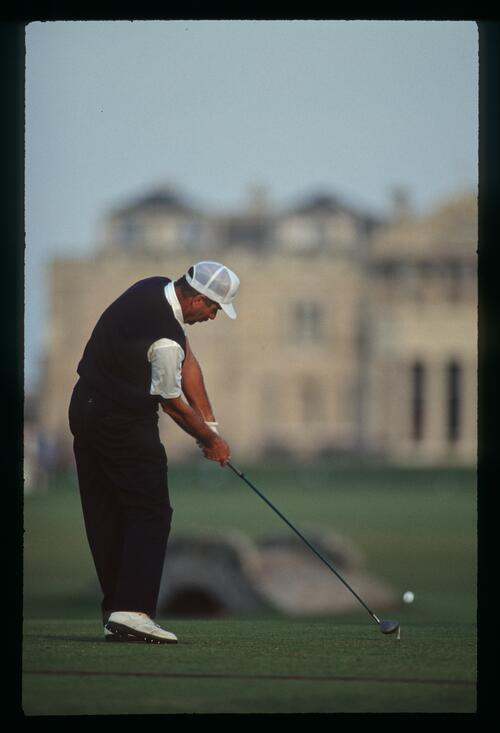 English golfer Mark James tees off on the 18th hole of the Old Course in St Andrews during the 1990 Dunhill Cup