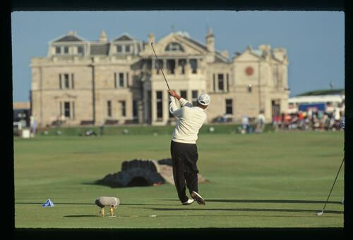 English golfer Mark James drives towards the clock on the R&A from the 18th tee at the 1990 Dunhill Cup Championship