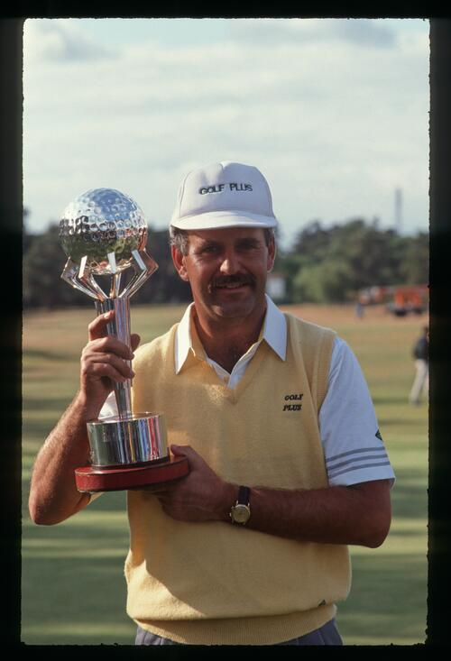 Golfer Mark James lifts the trophy after winning the 1990 Dunhill British Masters Championship at Woburn