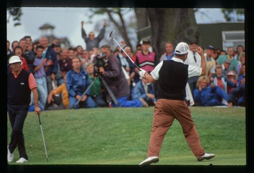 Mark James holes his putt to claim victory at the 1990 English Open Championship at The Belfry