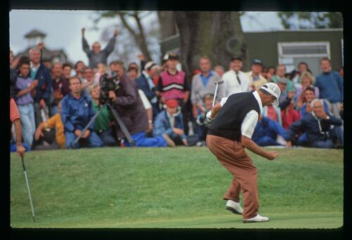 English golfer Mark James celebrates his victory at the 1990 English Open Championship at The Belfry