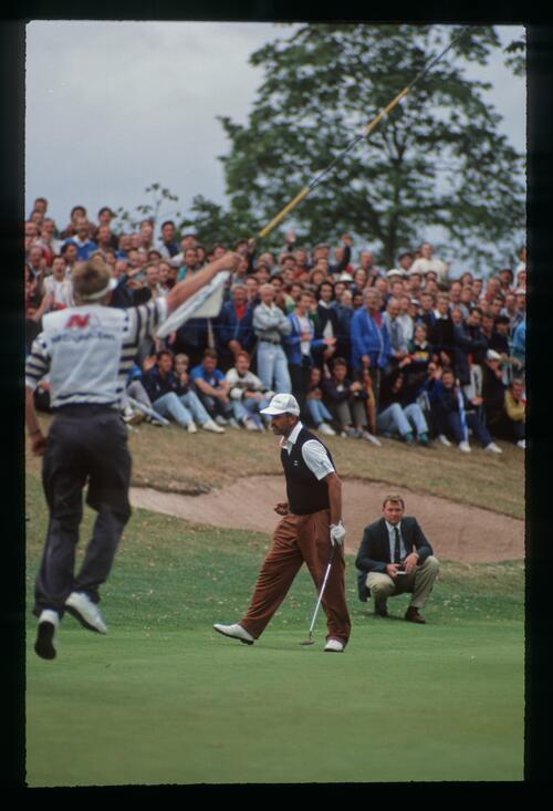 A victorious Mark James tries to calm himself after holing his putt for the win at the 1990 English Open Championship