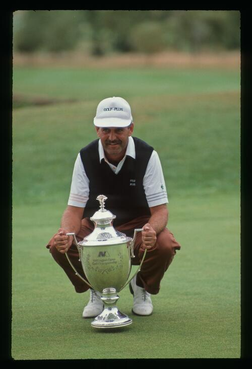 Mark James flashes a winning smile with the victor's trophy at the 1990 English Open Championship