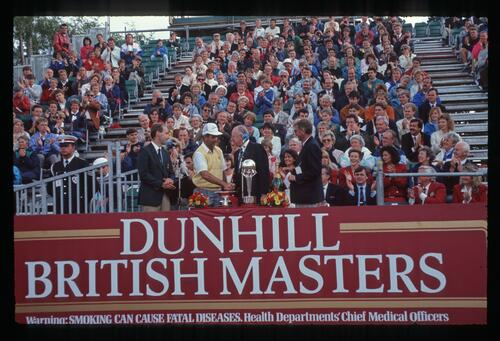 A victorious Mark James accepts a handshake at the awards presentations of the 1990 Dunhill British Masters Champioship