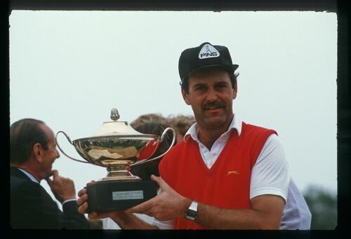 Englishman Mark James lifts the winner's trophy at the 1985 GSI-L'Equipe Open Championship at Le Touquet