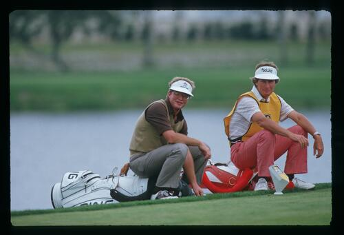 Golfer Tom Kite and caddie wait patiently on the tee at the 1987 Bay Hill Classic