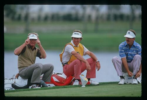 Golfer Tom Kite is aware of the press camera as he sits by the tee box at the 1987 Bay Hill Classic