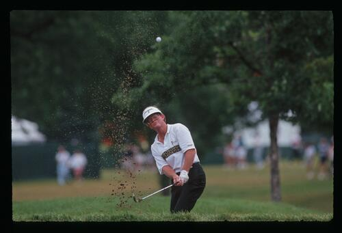 Tom Kite blasts his shot from the bunker at the 1991 United States Open Championship