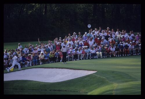Ray Floyd, his caddie and the gallery begin to celebrate a birdie two on the 16th during the 1992 Masters
