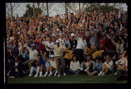 Sam Torrance leads the charge and the cheers as a vital putt drops for Europe at the 1989 Ryder Cup