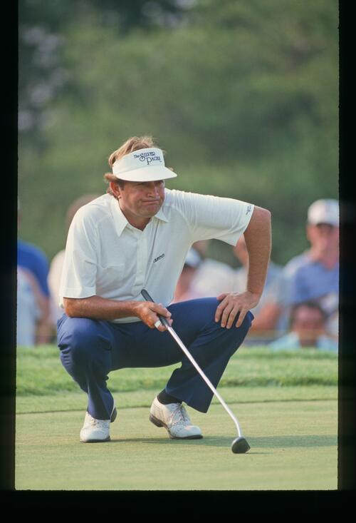 Ray Floyd is conflicted over the line of his putt at the 1986 United States Open Championship