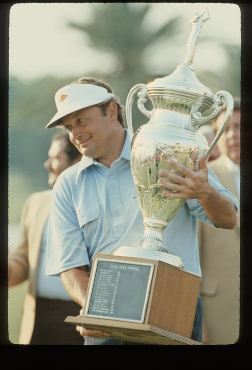 Winner ray Floyd struggles to lift the trophy at the 1981 Doral eastern Open Championship