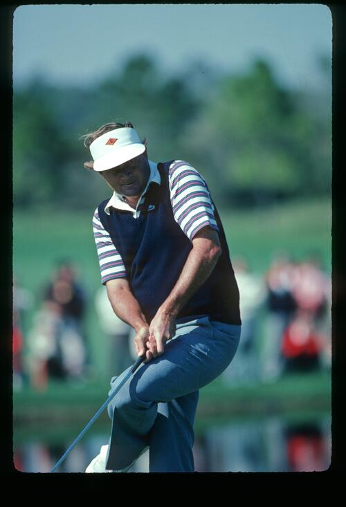 Golfer Ray Floyd attempts his putt at the 1982 Bay Hill Classic