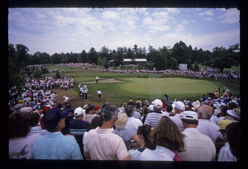 Huge crowds surround the tight fairway and green during the 1989 US Open Championship