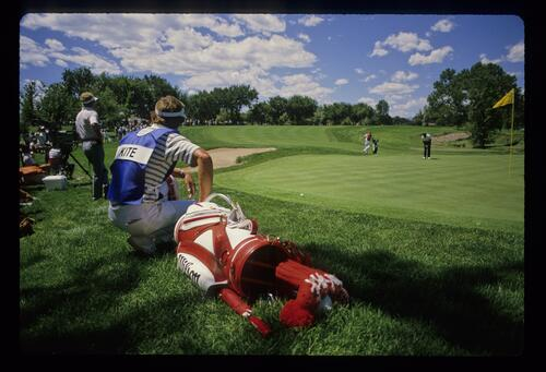 Tom Kite and his caddie watch Severiano Ballesteros putt during the 1985 USPGA